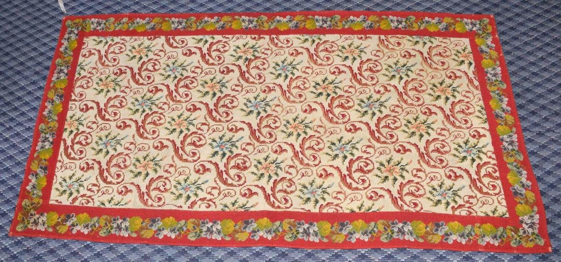 NEEDLEPOINT RUG. 67''L x 36''W. Provenance: Mail Pouch