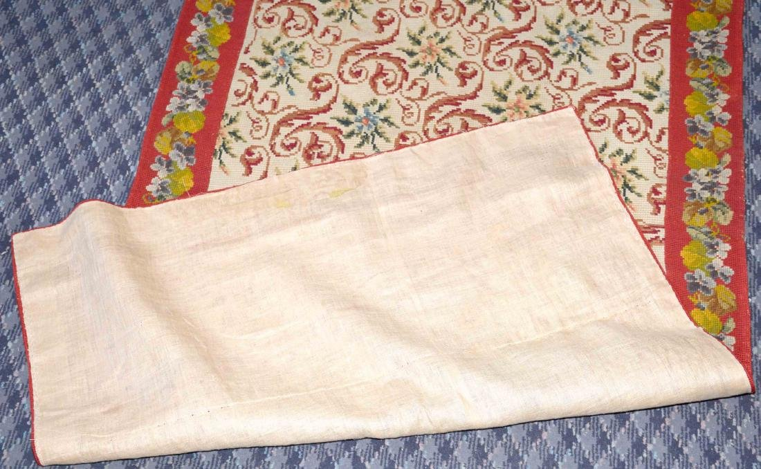 NEEDLEPOINT RUG. 67''L x 36''W. Provenance: Mail Pouch - 5