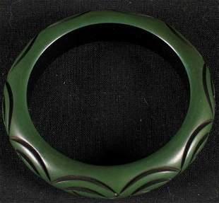 BAKELITE BRACELET. The bracelet is green with a c
