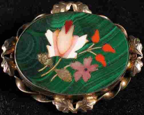 PIETRA DURA BROOCH. The brooch has a sterling fra