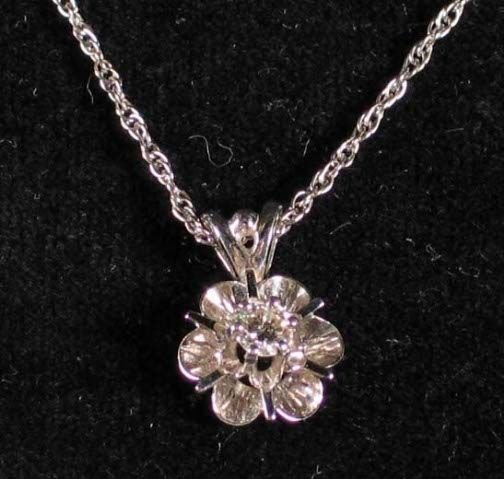 1010: 14K DIAMOND NECKLACE. The necklace has a diamond