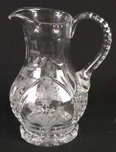 1575: CUT GLASS PITCHER. Cut glass crystal pitcher, sta