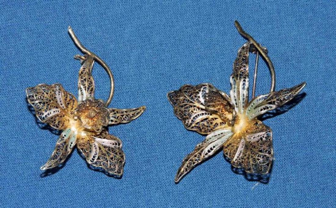 (2) ANTIQUE FLORAL ORCHID VERMEIL FILLIGREE BROOCHES.