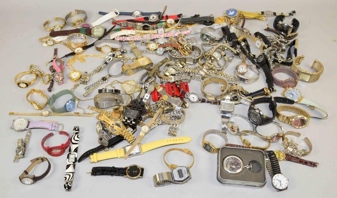 BIN OF ASSORTED LADIES AND MENS WATCHES.
