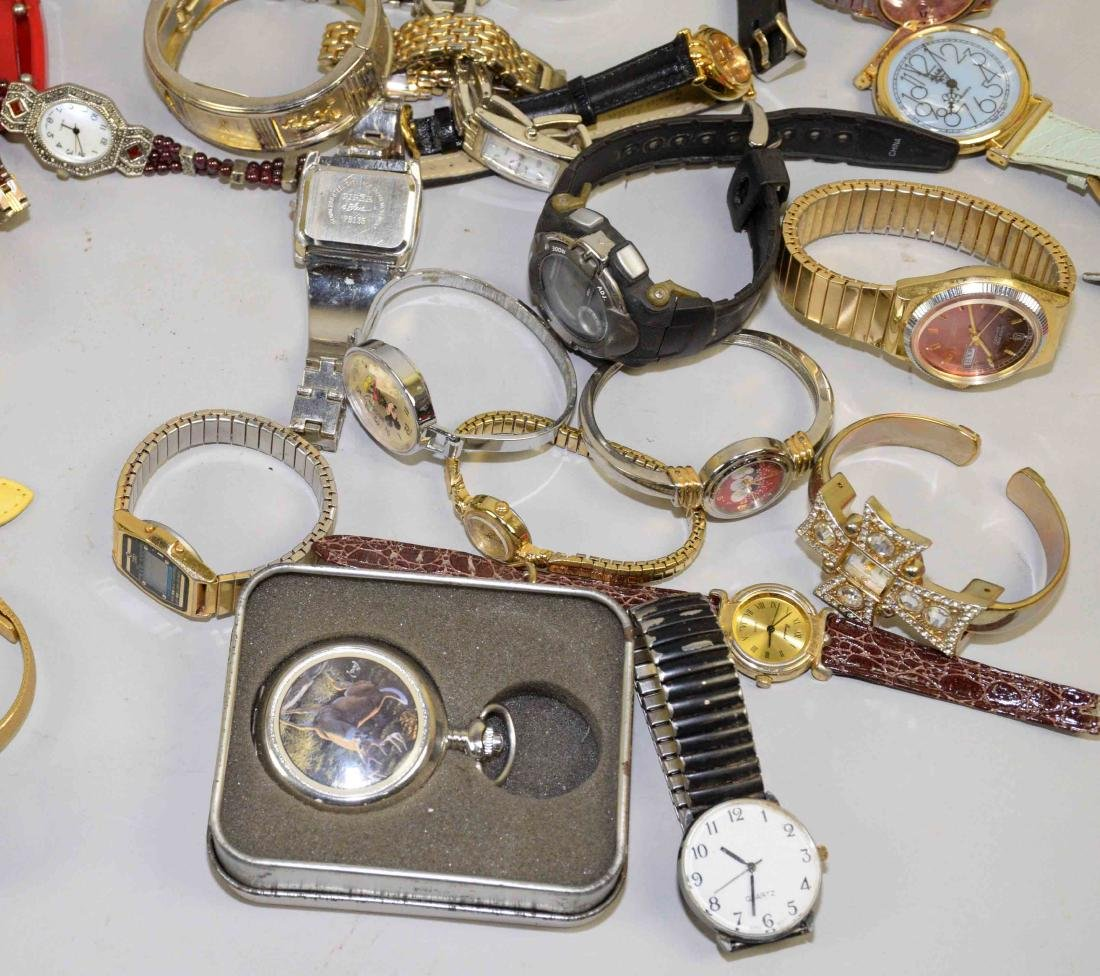 BIN OF ASSORTED LADIES AND MENS WATCHES. - 9