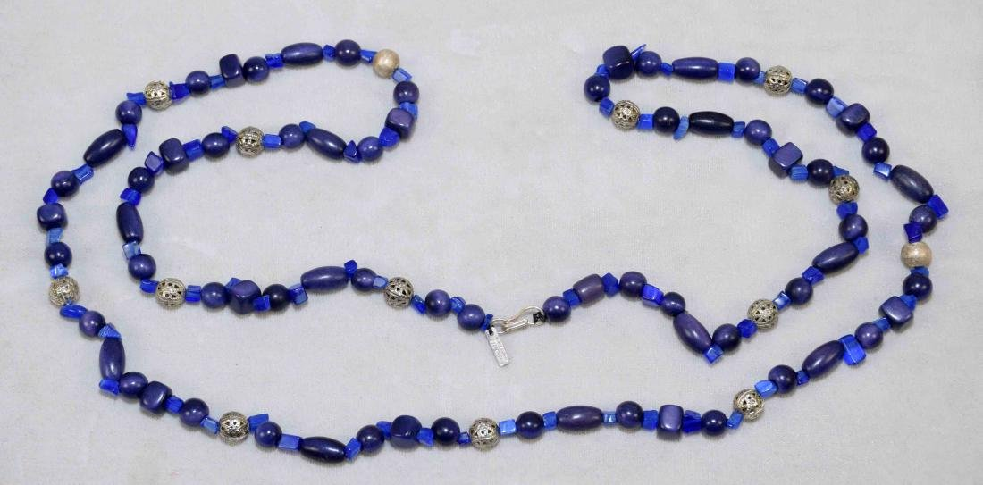 DESIGNER SIGNED STERLING AND LAPIS BEADED NECKLACE.