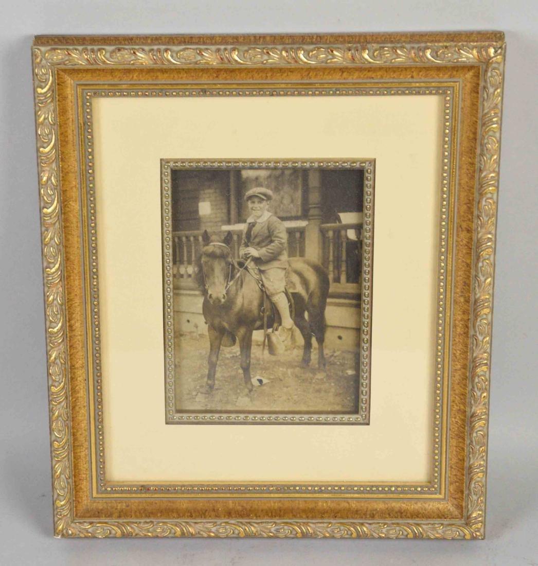 PHOTO OF BOY ON HORSE, framed. 10.5''H x 9''W.