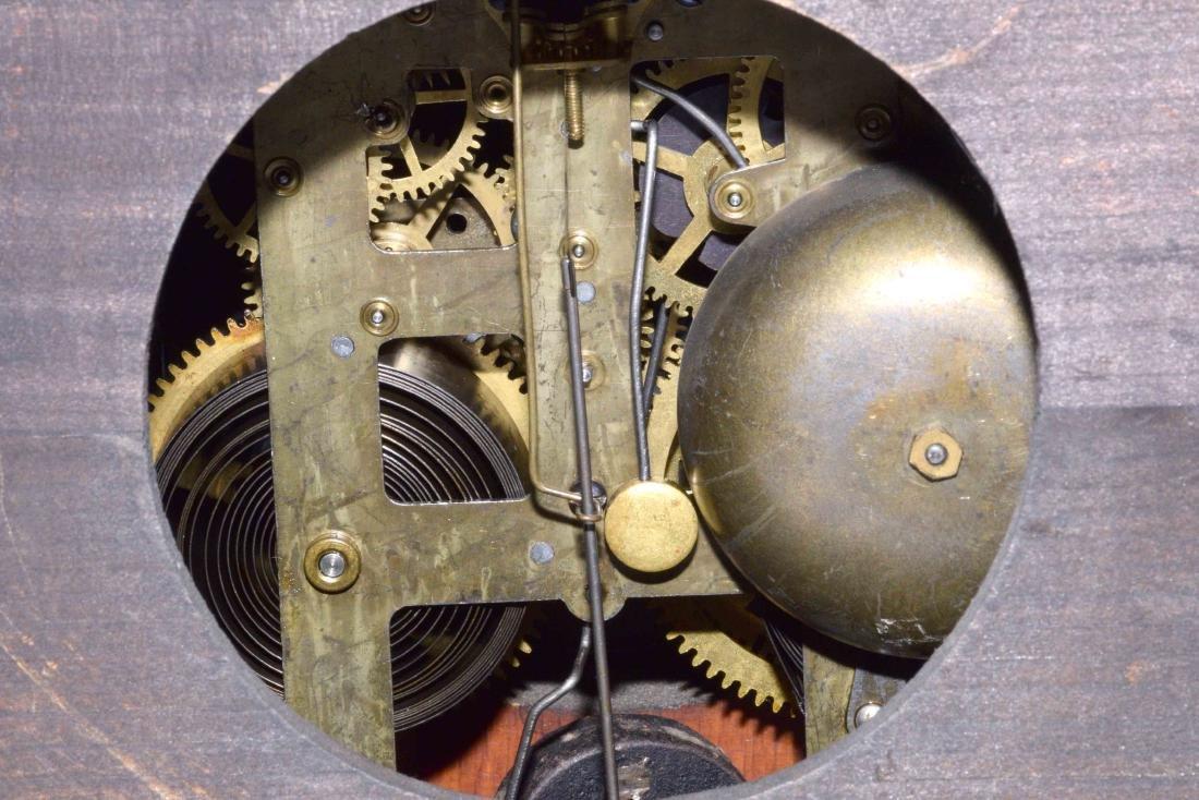 ANTIQUE WOOD AND BRONZE MANTEL CLOCK. 11''H x 13.5''L x - 6