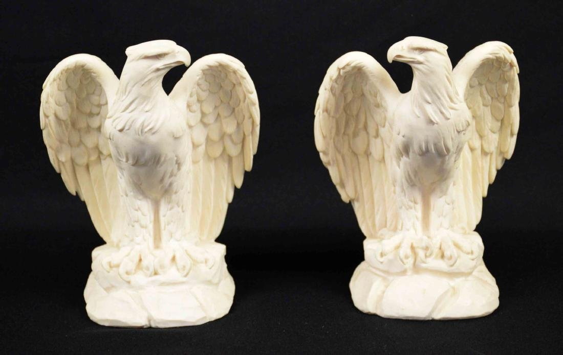 PAIR OF COMPOSITE EAGLE SCULPTURES, signed A.