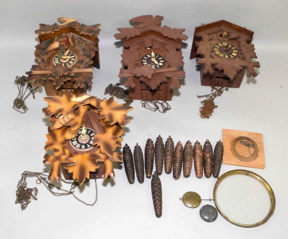 (4) ASSORTED GERMAN CUCKOO CLOCKS. Not in working