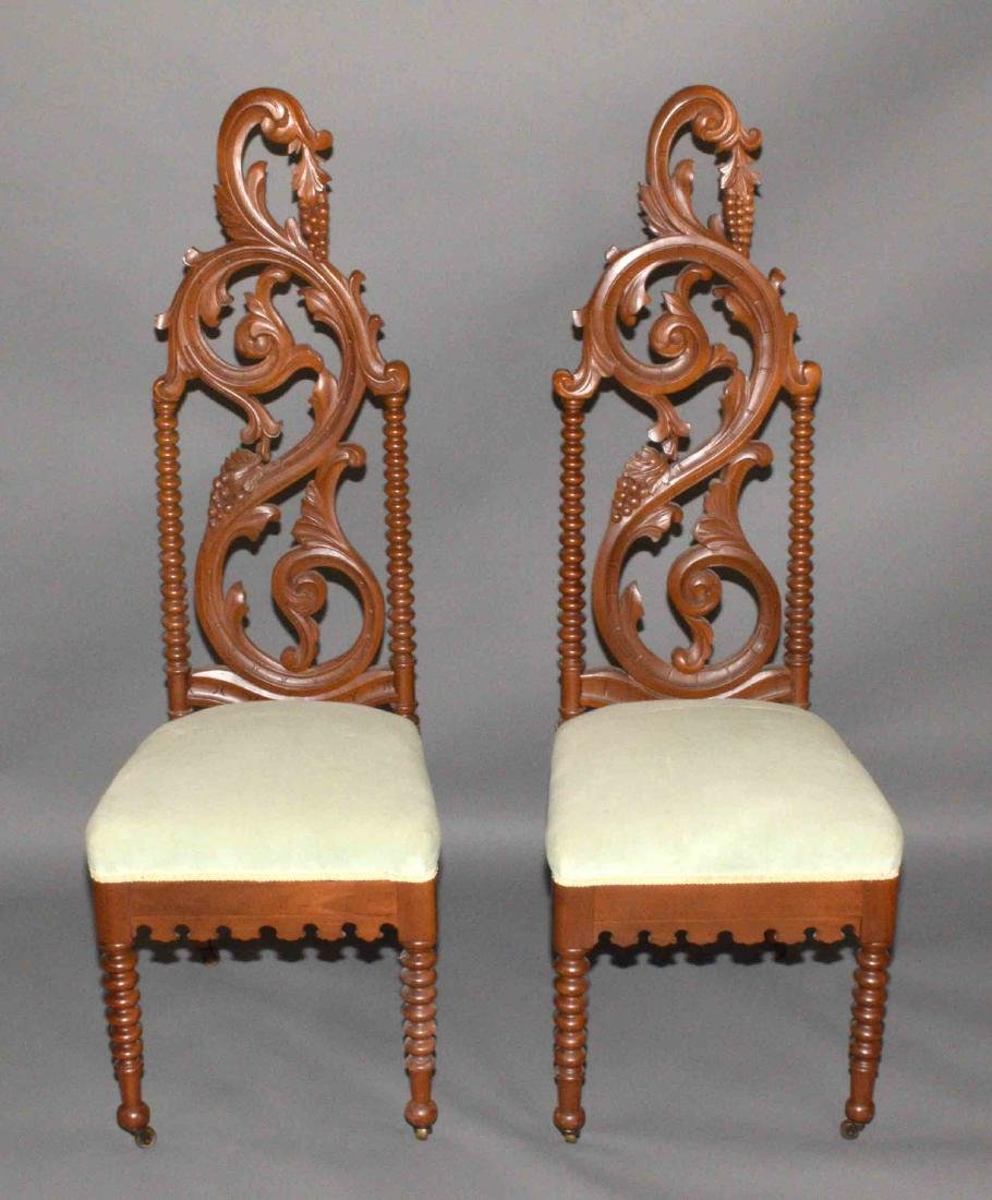 PAIR OF CARVED PARLOR CHAIRS. 48''H x 17''W.