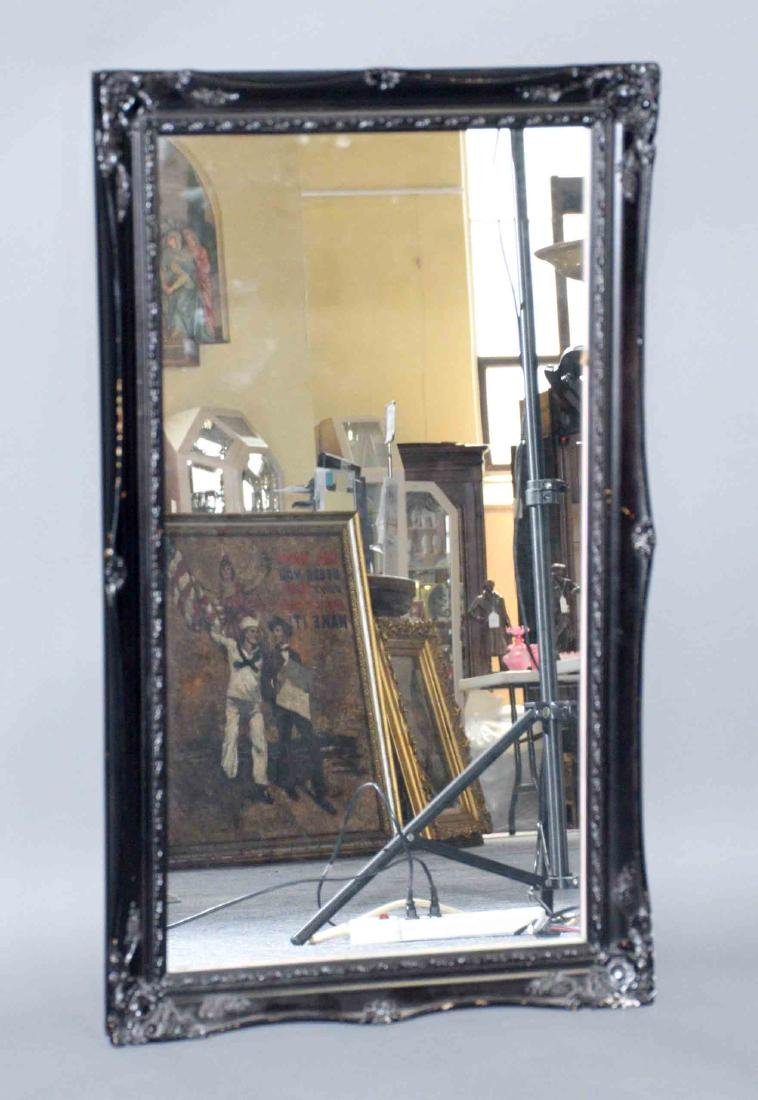 MIRROR WITH BLACK FRAME. 29.5''H x 17.5''W.