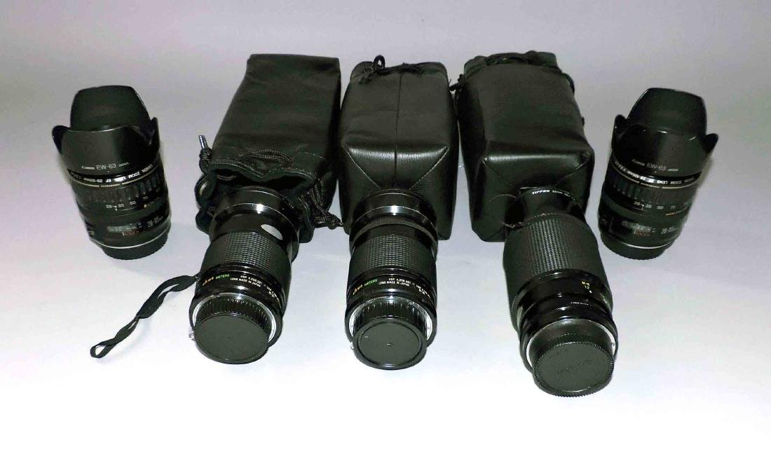 A group of lenses consisting of (2) Canon EW-63,