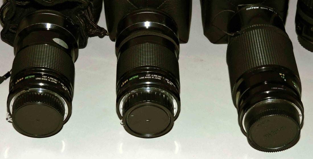 A group of lenses consisting of (2) Canon EW-63, - 2