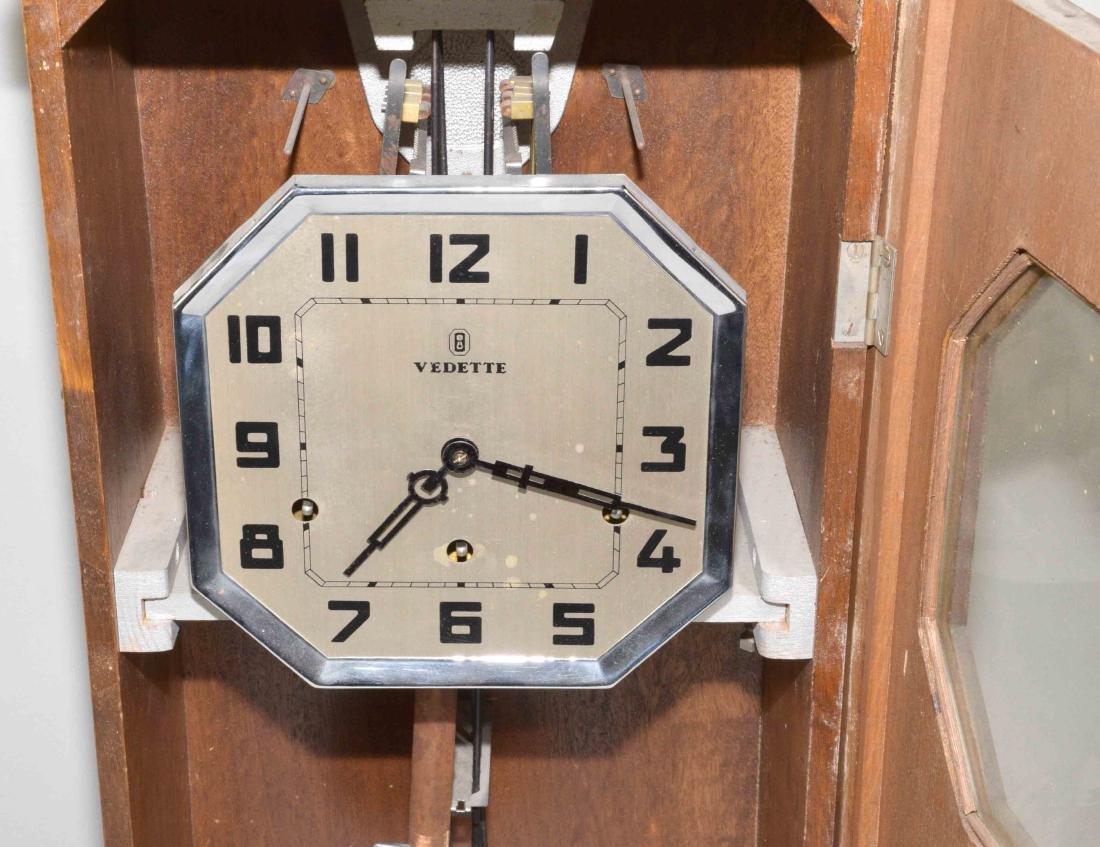 VEDETTE ART DECO REGULATOR CLOCK. 27''H x 12.5''W x - 5