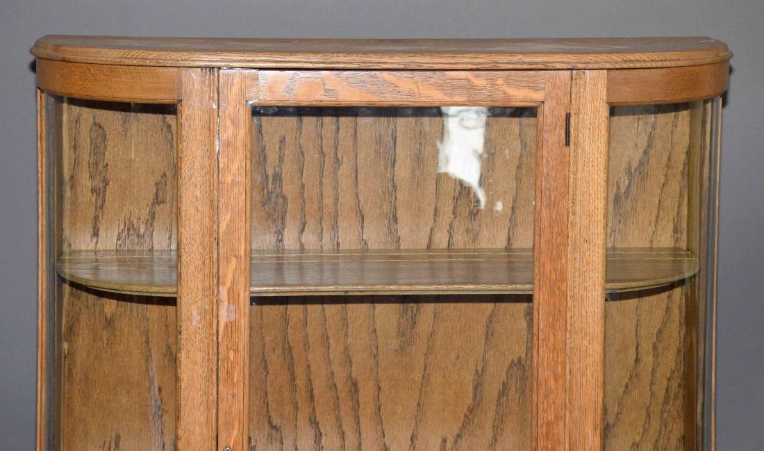 ANTIQUE CURVED GLASS OAK CABINET. 59''H x 34''W x - 3