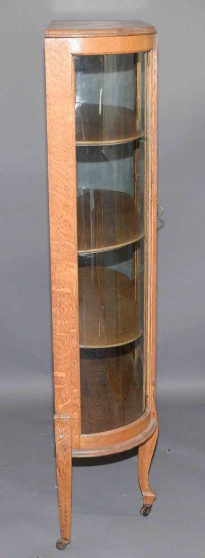 ANTIQUE CURVED GLASS OAK CABINET. 59''H x 34''W x - 4