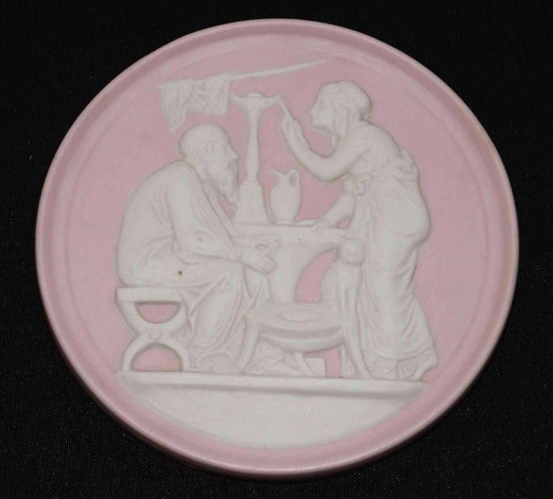 PINK JASPERWARE PLAQUE. Pink jasperware plaque, round
