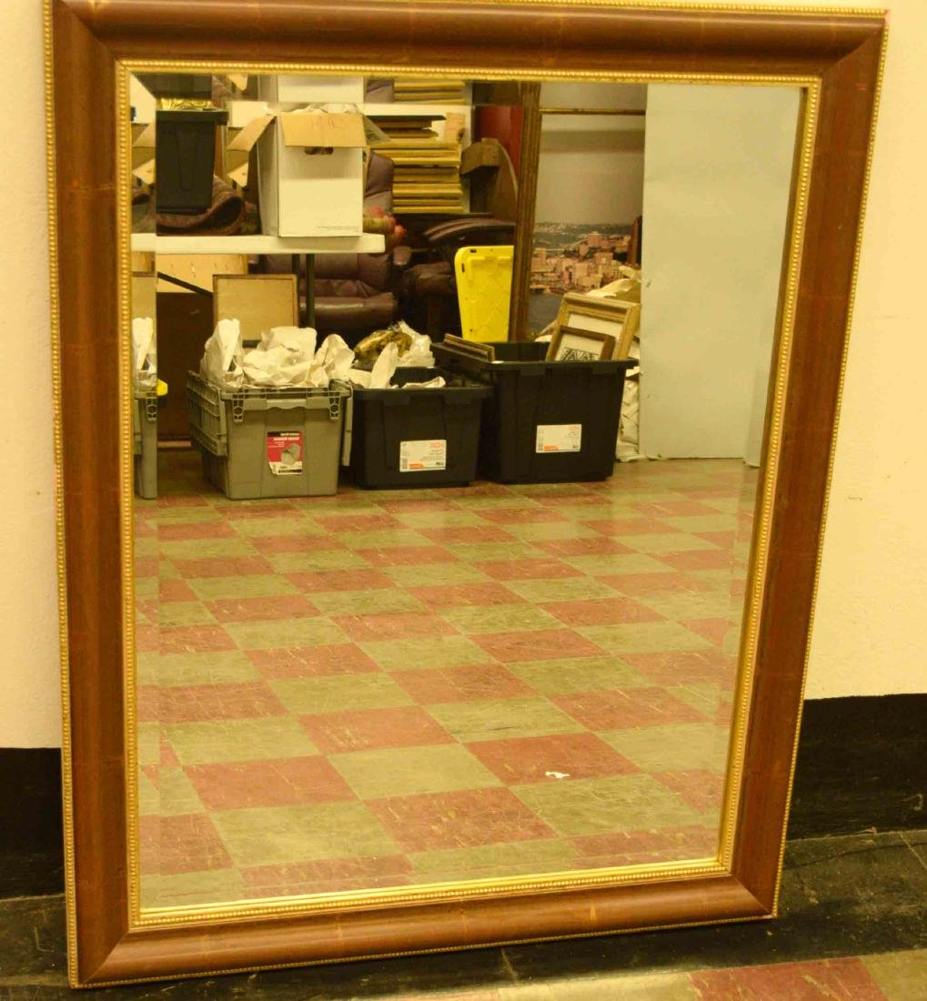 BROWN AND GOLD WOOD FRAMED MIRROR. 42''h x 34''w.