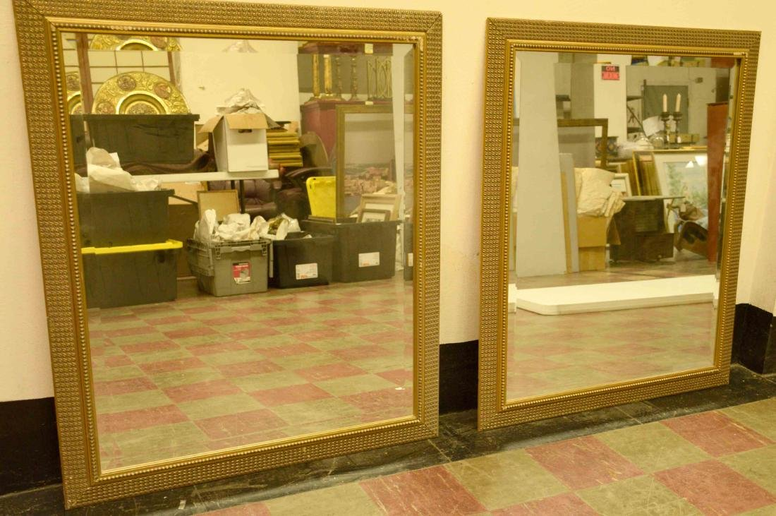 PAIR OF DECORATIVE WOOD FRAMED MIRRORS. 42''h X 36''w