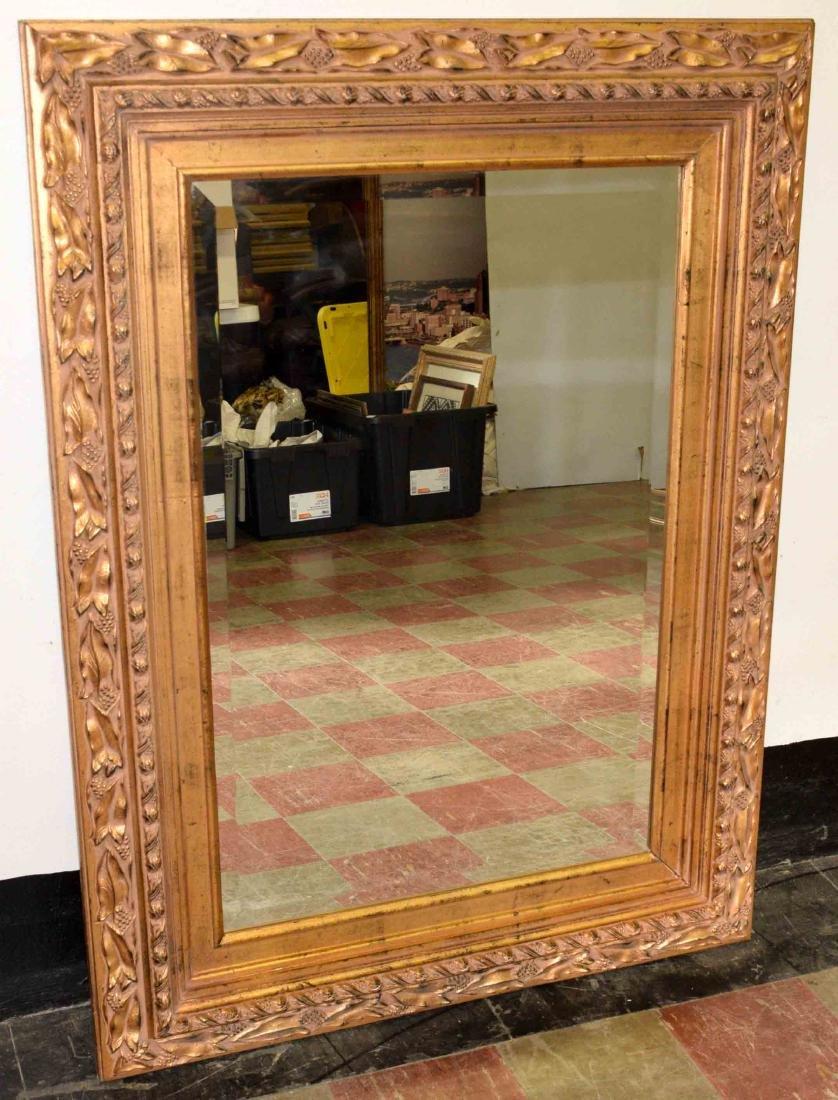 GOLD WOOD FRAMED WALL MIRROR. 48.75''h x 36.75''w.