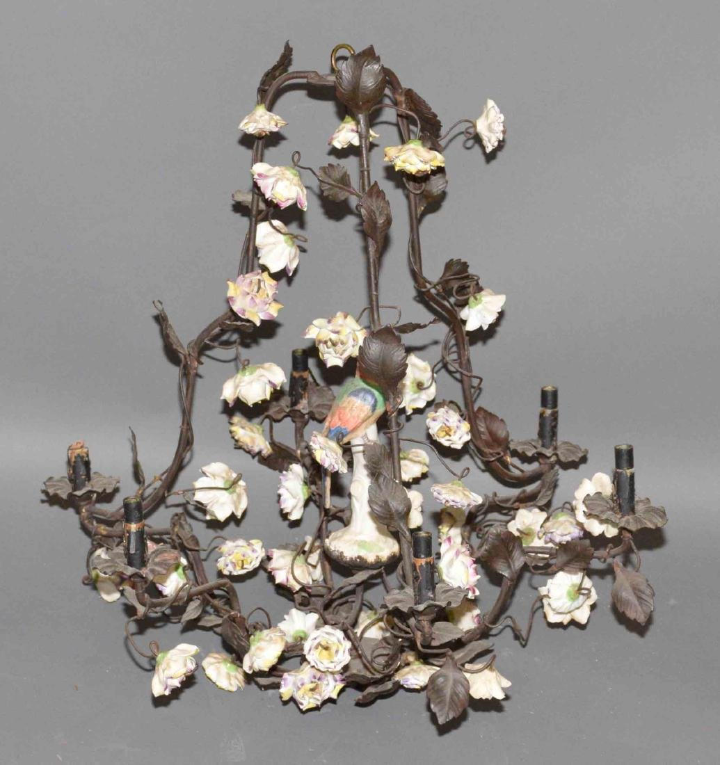 ANTIQUE HANGING METAL AND CERAMIC FLOWER CHANDELIER.