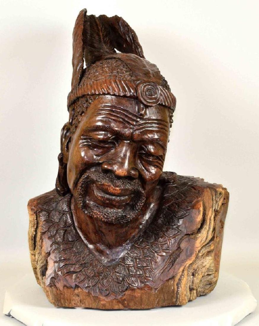 MOSES CHIKUMBR (ZIMBABWE) CARVED WOOD - Statue of a man;