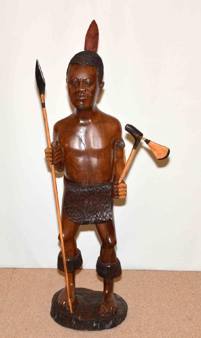 BEAUTIFULLY CARVED MAHOGANY AFRICAN WARRIOR. 46''H.
