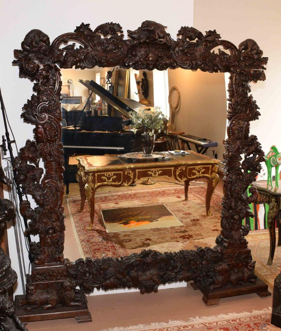 COLOSSAL ORNATELY CARVED MIRROR. Once used as a