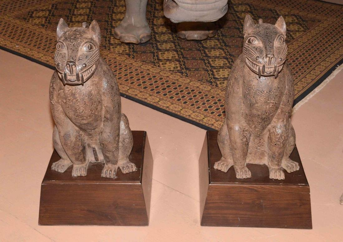 ANTIQUE PAIR OF BENIN BRONZE CATS. Male and female on