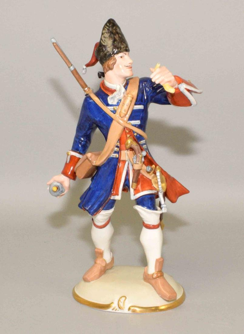 NYMPHENBURG PORCELAIN SOLDIER THROWING A BOMB, 10.5''H.