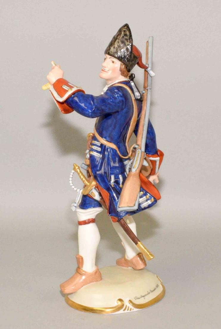NYMPHENBURG PORCELAIN SOLDIER THROWING A BOMB, 10.5''H. - 2