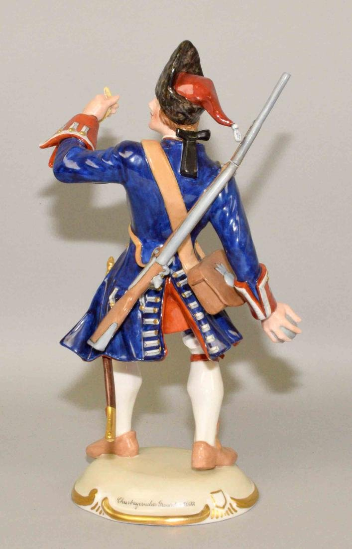 NYMPHENBURG PORCELAIN SOLDIER THROWING A BOMB, 10.5''H. - 3