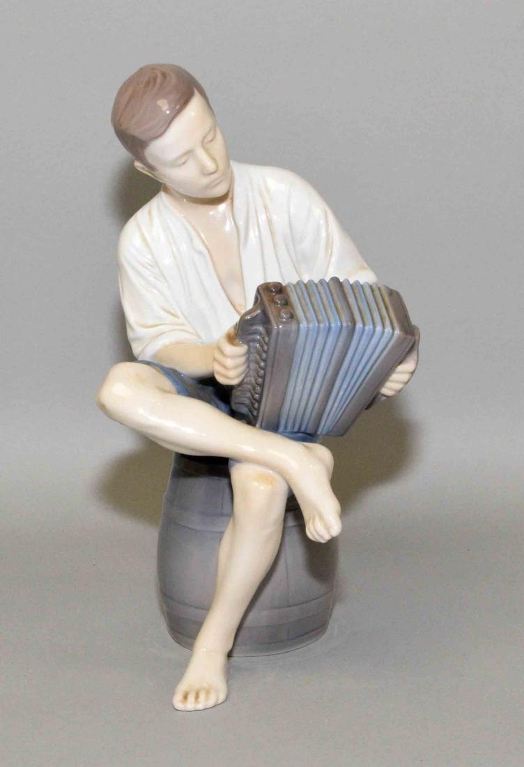 BING AND GRONDAHL FIGURINE, boy playing accordian,