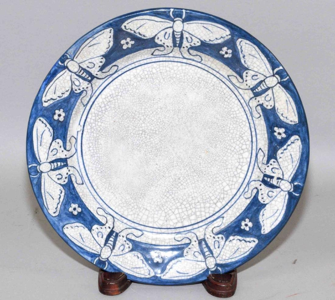 DEDHAM POTTERY PLATE WITH MOTH MOTIF. 8.5'' diameter.