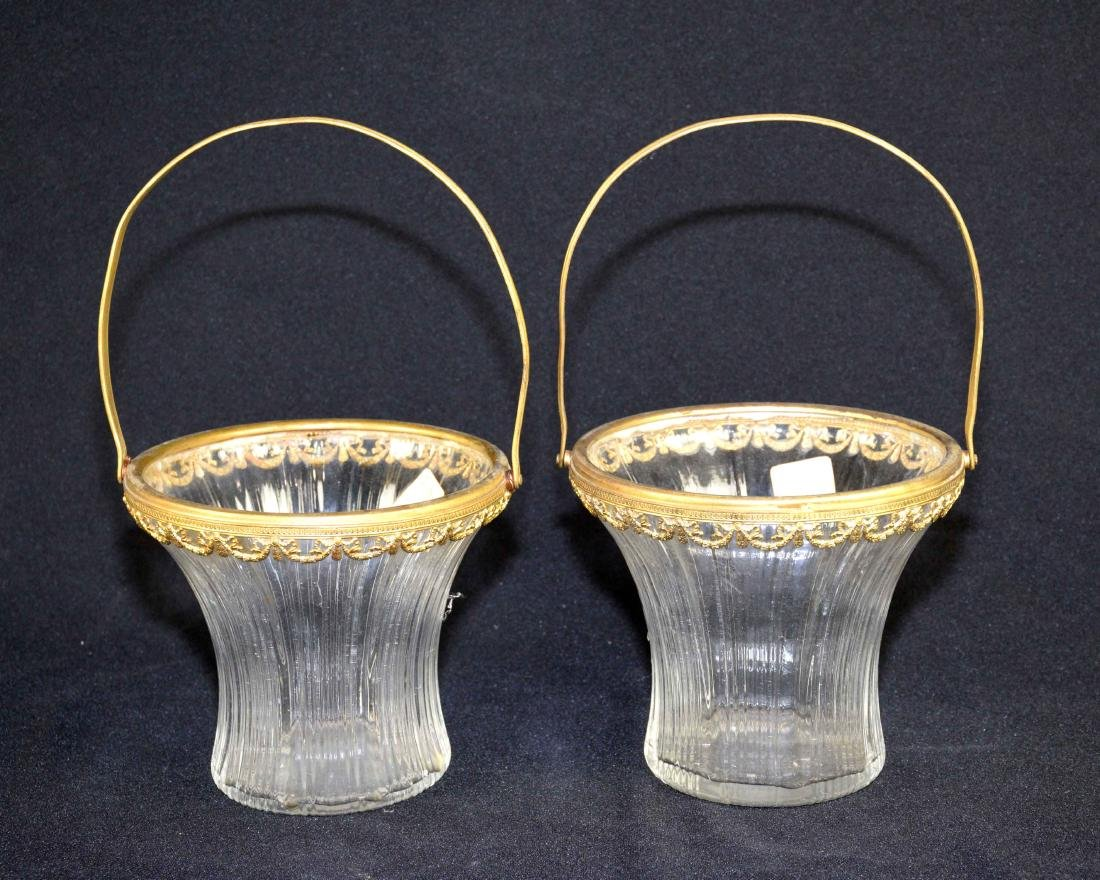 A PAIR OF FRENCH GILT-METAL MOUNTED AND COLORLESS GLASS