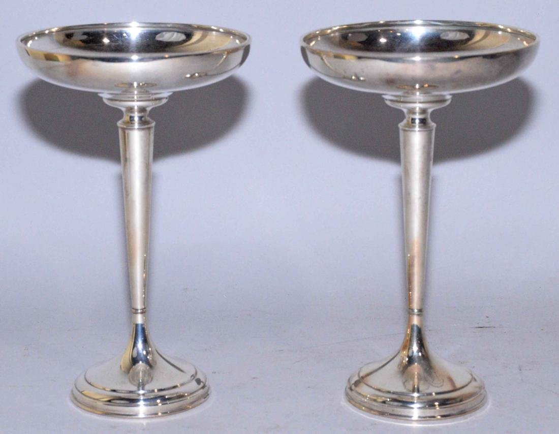 PAIR OF WEIGHTED STERLING COMPOTES. Sterling content -