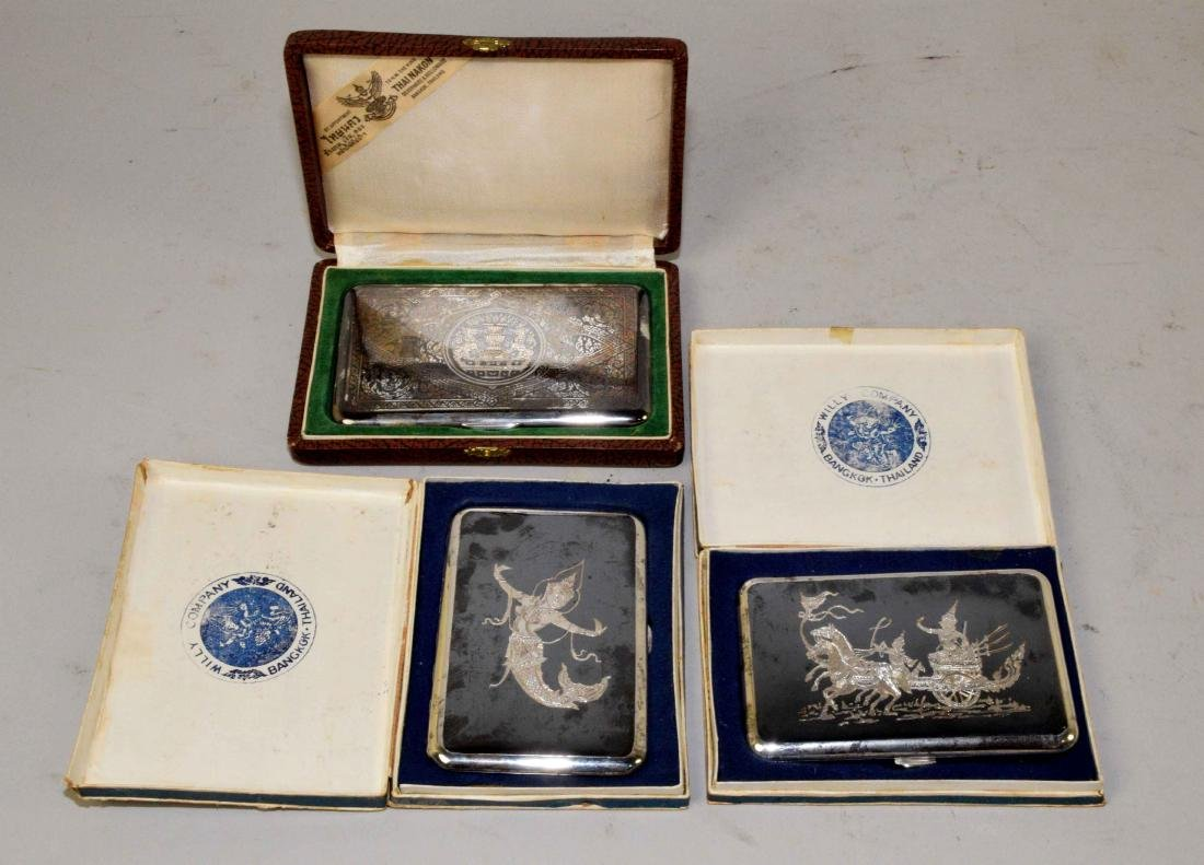 THREE THAI CIGARETTE BOXES. Sterling, beautifully