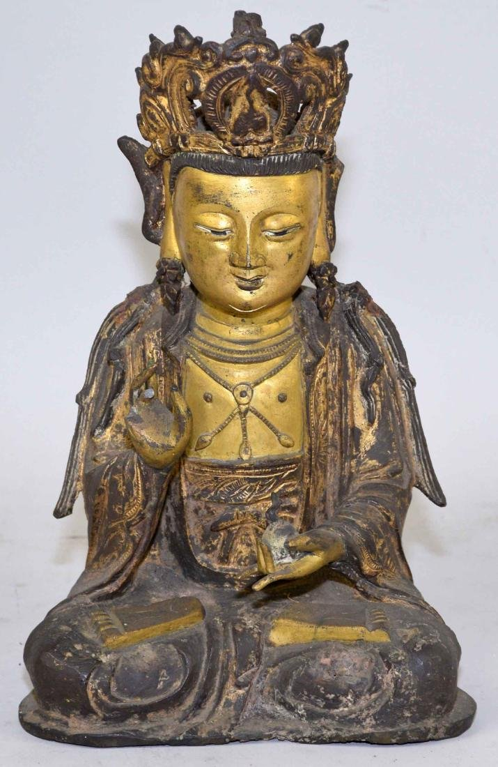 A CHINESE GILT-BRONZE FIGURE OF A SEATED BUDDHA. Ming