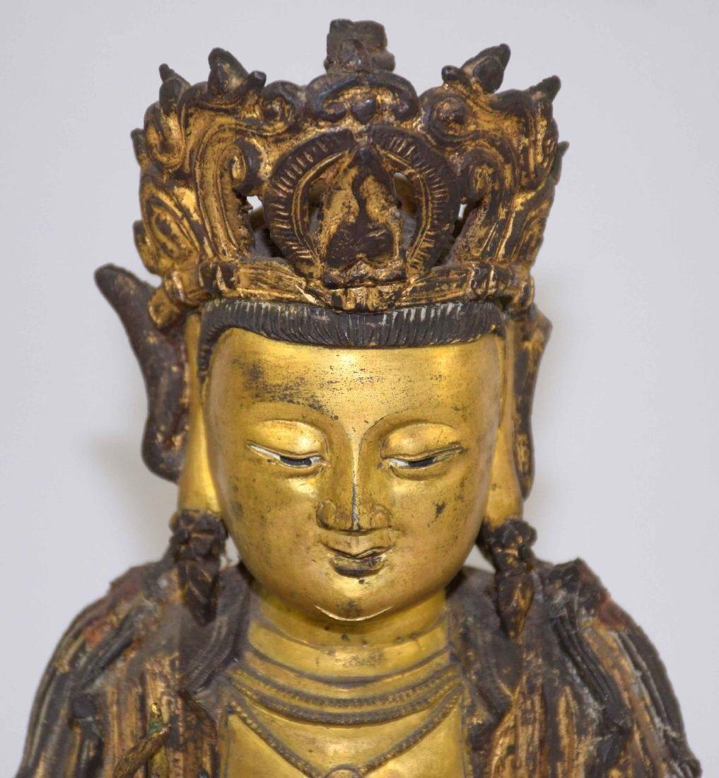 A CHINESE GILT-BRONZE FIGURE OF A SEATED BUDDHA. Ming - 2