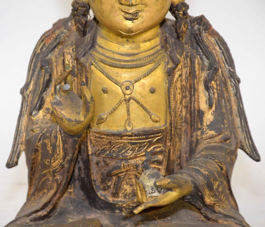 A CHINESE GILT-BRONZE FIGURE OF A SEATED BUDDHA. Ming - 3