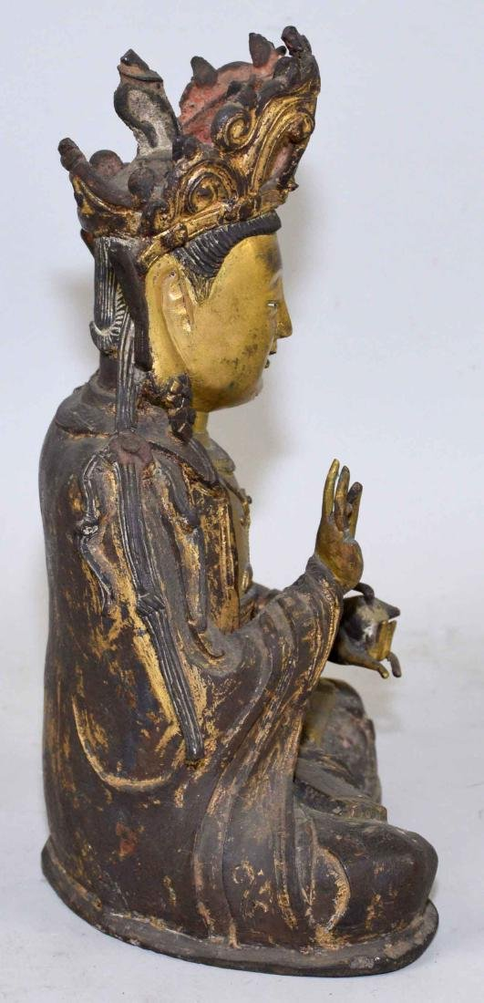 A CHINESE GILT-BRONZE FIGURE OF A SEATED BUDDHA. Ming - 5