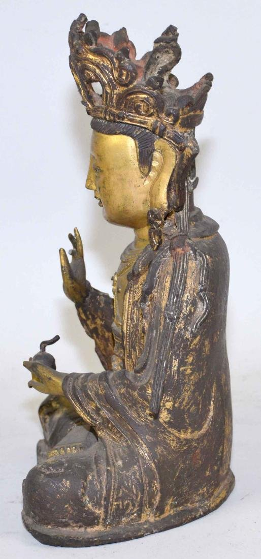 A CHINESE GILT-BRONZE FIGURE OF A SEATED BUDDHA. Ming - 8
