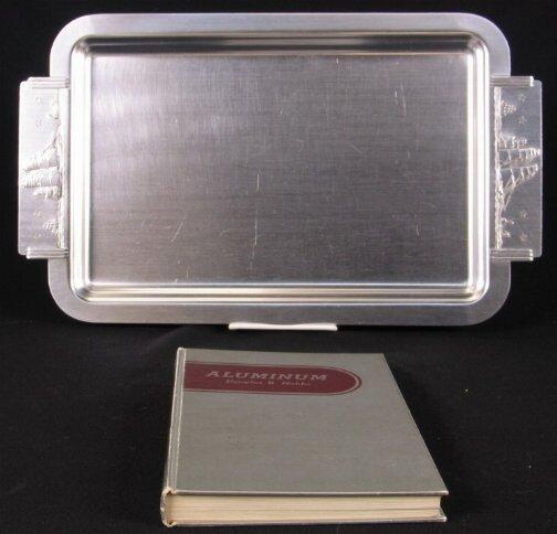 2043: 1938 ALUMINUM BOOK AND TRAY. (1) ''Aluminum: Its