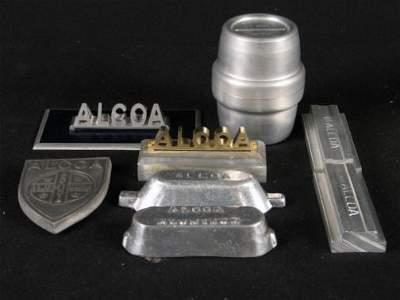2064: 8 ALCOA ITEMS. Includes: (1) small shield Alcoa l
