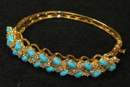 3021: 14K TURQUOISE BRACELET. The bangle bracelet has t