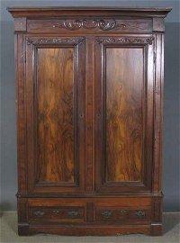 3197: ROSEWOOD PANELED ARMOIRE. 19th century, walnut wi