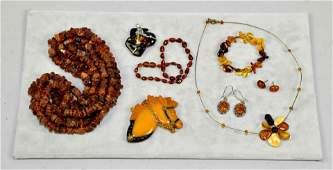 8 MISC PCS OF AMBER COSTUME JEWELRY To include