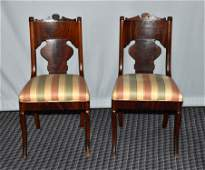 PAIR VICTORIAN ROCOCO CARVED WALNUT SIDE CHAIRS; mid