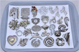 25 MISCELLANEOUS LADIES SILVER TONE BROOCHES